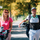 Couple on the golf course, walking to the next hole, enjoying a beautiful sunny autumn day - PhotoDune Item for Sale