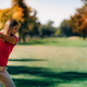 Golfing lady in a golf swing, shot from behind - PhotoDune Item for Sale
