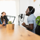 Multiracial people recording a podcast using microphone and laptop from home studio - PhotoDune Item for Sale