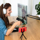 Mature woman recording a podcast using microphone and laptop while streaming on social network - PhotoDune Item for Sale