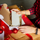 DIY, Man in Santa hat making greeting card for New Year and Christmas for friends or family - PhotoDune Item for Sale