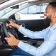 Buying Auto. Black Man Sitting Inside Of Car And Holding Steering Wheel - PhotoDune Item for Sale