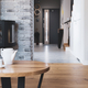 Stylish living room interior with wooden floor, brick wall and fireplace - PhotoDune Item for Sale