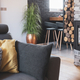 Grey couch with pillows next to modern fireplace in stylish living room interior - PhotoDune Item for Sale