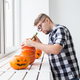 Hollowing out a pumpkin to prepare halloween lantern - PhotoDune Item for Sale