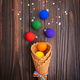 Waffer cones with rainbow color balls and confetti on wooden background. - PhotoDune Item for Sale