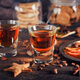 Whiskey or liqueur, cookies, spices and decorations on wooden background. - PhotoDune Item for Sale