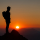Mountaineer on the top of the mountain watching the fantastic sunset - PhotoDune Item for Sale