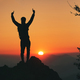 Man in silhouette in front of idyllic sunset in the hills - PhotoDune Item for Sale