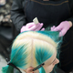 Top view of head of young woman with green hair and bleached hair roots in professional beauty salon - PhotoDune Item for Sale