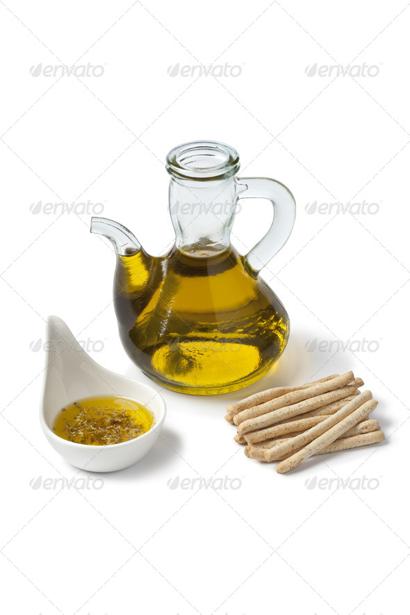 Olive oil with dipper herbs and breadsticks - Stock Photo - Images