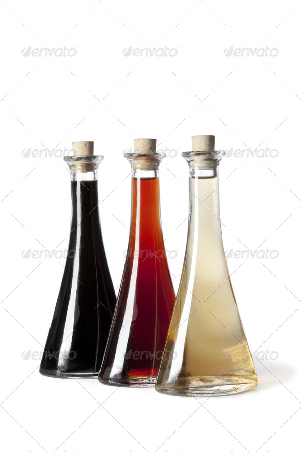 Three bottles with different type of vinegar - Stock Photo - Images