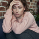 Depressed young caucasian woman sitting at home alone - PhotoDune Item for Sale