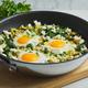 Green shakshouka. Fried in pan. Eggs, parsley, celery, spinach, sheep cheese, pepper - PhotoDune Item for Sale