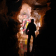 Cavers exploring a gallery in a cave - PhotoDune Item for Sale