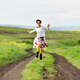Happy girl running on a countryside road - PhotoDune Item for Sale