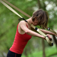 Young woman does suspension training with fitness straps in the outdoors - PhotoDune Item for Sale