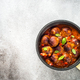 Meatballs in tomato sauce in a frying pan on dark stone table - PhotoDune Item for Sale
