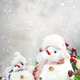 Christmas and new year snow concept with two cute snowmen in hats and scarves in snowdrift - PhotoDune Item for Sale