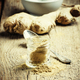 Ground ginger, old wooden background, selective focus - PhotoDune Item for Sale