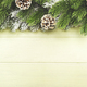 Christmas or New Year green background with fir branches, pine cones, top view banner - PhotoDune Item for Sale