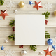Mockup paper blank on christmas tree branches which has a wooden back. - PhotoDune Item for Sale