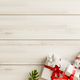 Christmas frame made and Christmas gifts on wooden background. - PhotoDune Item for Sale