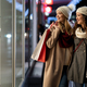Two beautiful happy women with shopping bags in the city next to shop window background - PhotoDune Item for Sale