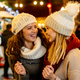 Christmas shopping people concept. Happy young women with shopping bags buying presents - PhotoDune Item for Sale