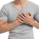 Cropped millennial european muscular male suffering from chest pain, presses hand to sore spot - PhotoDune Item for Sale
