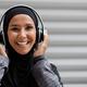 Cheerful Muslim Woman In Hijab And Wireless Headphones Listening Music Outdoors - PhotoDune Item for Sale