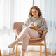 woman resting on armchair at home - PhotoDune Item for Sale