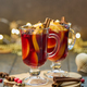 Closeup of seasonal red mulled wine drink. Selective focus, blurred background - PhotoDune Item for Sale
