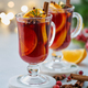 Closeup of claret red mulled wine on white coaster. Selective focus, blurred background, closeup - PhotoDune Item for Sale