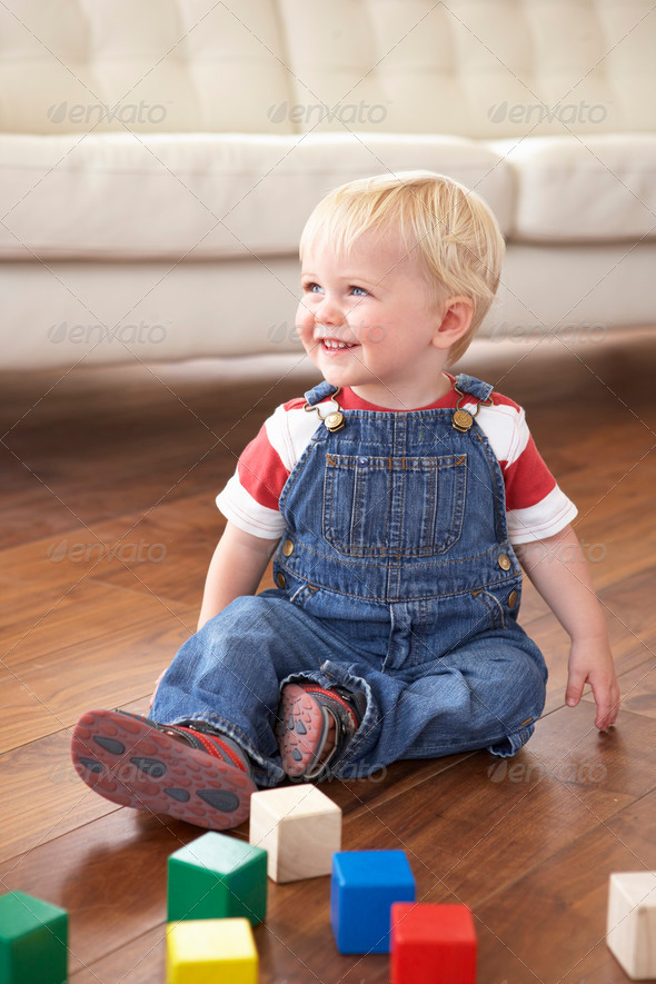 Young Boy Playing With Coloured Blocks At Home - Stock Photo - Images