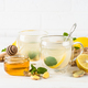 Ginger tea with lemon at white table - PhotoDune Item for Sale
