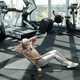 Young pretty sportswoman doing sit-ups with side turns - PhotoDune Item for Sale