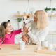 Happy granddaughter and grandmother in the kitchen with jack russell terrier dog. Grandma and - PhotoDune Item for Sale