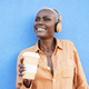Mature african woman listening music playlist from smartphone app - PhotoDune Item for Sale