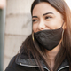 Beautiful young latin woman wearing safety face mask for coronavirus outbreak - PhotoDune Item for Sale