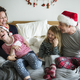 Family in the bedroom on Christmas day - PhotoDune Item for Sale
