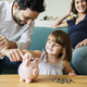 Family saving money in piggy bank - PhotoDune Item for Sale