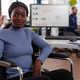Portrait of smiling disabled paralyzed african american businesswoman in wheelchair - PhotoDune Item for Sale