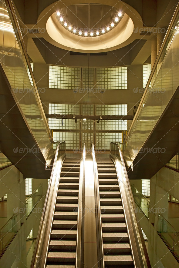 Golden interior escalator in business architecture - Stock Photo - Images