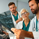 Group of radiology doctor looking at x-ray and discussing it - PhotoDune Item for Sale