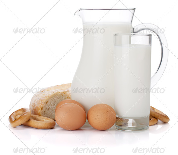 Milk jug, glass, eggs and bread - Stock Photo - Images