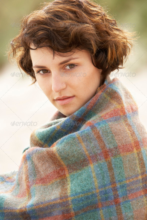 Young Woman Standing In Sand Dunes Wrapped In Blanket - Stock Photo - Images