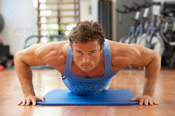 Man Doing Press Ups In Gym - Stock Photo - Images