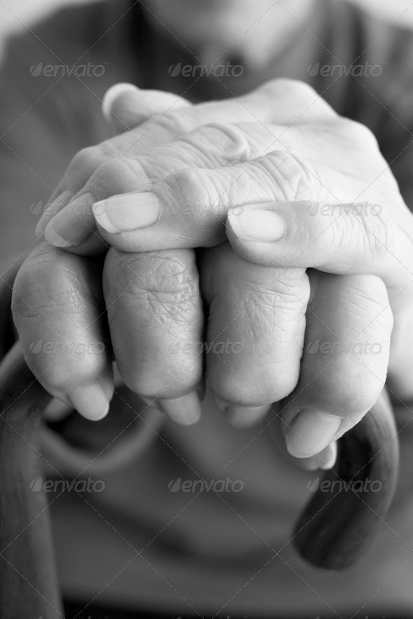 Close-Up Of Elderly Persons Hand Resting On Walking Cane - Stock Photo - Images