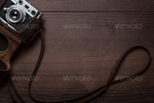 Wooden Background With Retro Still Camera In Case - Stock Photo - Images